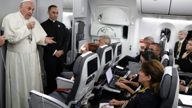 Pope Francis talks to journalists during a press conference on board the flight to Rome after a five-day visit to Colombia.