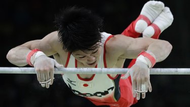 Japan's Kohei Uchimura performs on the horizontal bar during the artistic gymnastics men's individual all-around final.