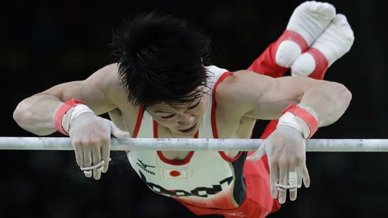 Japan's Kohei Uchimura performs on the horizontal bar during the artistic gymnastics men's individual all-around final.