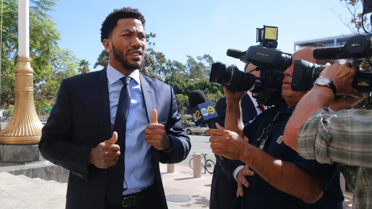 NBA star Derrick Rose outside court in 2016. His lawyer, Mark Baute, said media reporting on this case was biased against the black men.