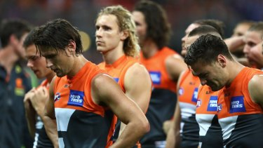 Shattered: Giants players looks dejected after being defeated by the Western Bulldogs.