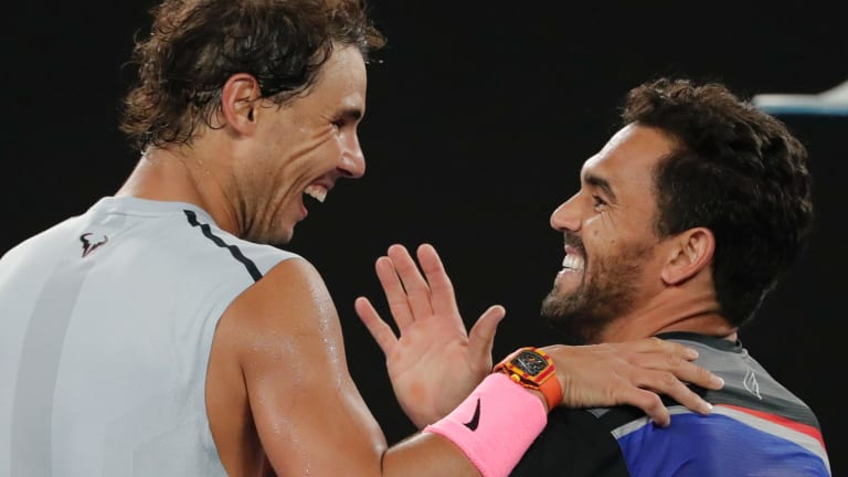 Nadal is congratulated by Victor Estrella Burgos during their first round match at the Australian Open.