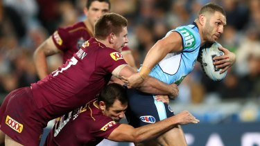 State against state: Robbie Farah is tackled during game three of the State Of Origin series, which will head to Perth in 2019.