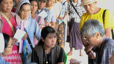 Myanmar Australia Conolly Foundation. November 2015. Queue at the MACF temporary clinic in the hill village of Leik Tho, Myanmar. Dr Raymond Wong sees a patient. Photo: Dr Tim Peltz.