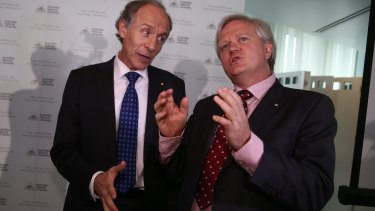 Chief Scientist Alan Finkel (left) and ANU Vice-Chancellor Brian Schmidt celebrate the detection of gravitational waves at Parliament House on Friday.