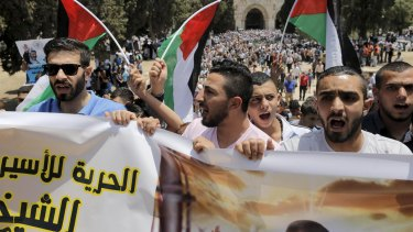 Demonstrators on the compound known to Muslims as the Noble Sanctuary and to Jews as Temple Mount in Jerusalem's Old City on Friday marked the 48th anniversary of the 1967 Middle East war, when Israel captured East Jerusalem, the Gaza Strip, the West Bank and Golan Heights.