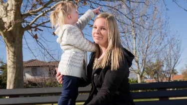 Cassandra Gibson with her two-year-old daughter, Ella, in a Perth park.