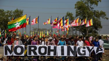 """Buddhist chauvinists belonging to the extremist Ma Ba Tha movement protest the use of the word """"Rohingya"""" as a donation ship from Malaysia arrives in Yangon on February 9, 2017."""