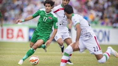 Free to play: Alaa Abdul-Zahra on the ball against Iran. A complaint about his appearance in the Asian Cup has been dismissed.