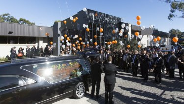 Balloons are released at the end of Myuran Sukumaran's funeral.
