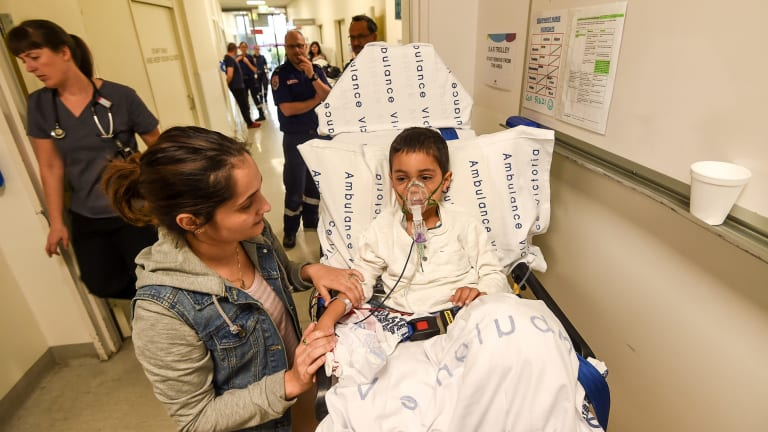 More than 8500 people were treated in Melbourne hospitals on Monday night and Tuesday: Rayann Zamani with mother Palli Zamani.