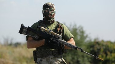 A pro-Russian rebel sniper at a checkpoint on the outskirts of Shakhtersk, in Ukraine's eastern Donetsk region, July 2014.