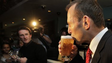 Tony Abbott enjoys a beer during his time as opposition leader.