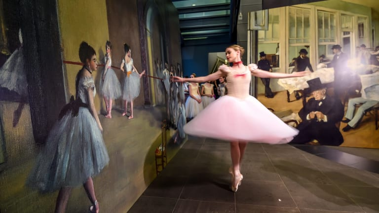 The Australian Ballet's Sarah Thompson dances in front of a print of Degas' <i>Rehearsal hall at the Opera, rue Le Peletier</i>, 1872, at the National Gallery of Victoria.