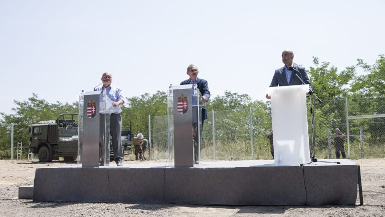 Hungarian interior minister Sandor Pinter (centre) and Defence Minister Csaba Hende (left) at press conference next to the first portion of the fence, on Wednesday.
