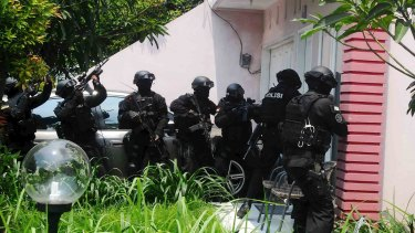 Armed anti-terror police conduct a raid at the house of a suspected Islamic State member at Petukangan district in Jakarta earlier this month.