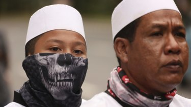 A youth wears a mask during a protest earlier this month against Jakarta governor Basuki Tjahaja Purnama, popularly known as Ahok.