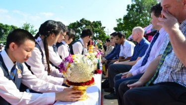 Students at the Narinukun school pay respect to teachers during a Thai ceremony on June 26, 2015.  Peter Dundas Walbran is third from right, wearing blue short-sleeve shirt.