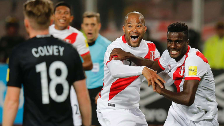 Peru's Christian Ramos, right celebrates after scoring his side's second goal.