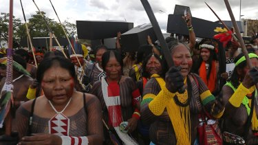 Indigenous women protest for the demarcation of indigenous lands outside the Brazilian National Congress in Brasilia on Tuesday.