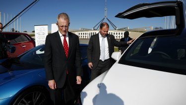 Minister for Urban Infrastructure Paul Fletcher and Minister for Environment and Energy Josh Frydenberg during an electric car event on the front lawn of Parliament House in Canberra.