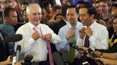 Informal: Malcolm Turnbull and Joko Widodo take off their ties during a visit to Tanah Abang market in Jakarta in November 2015.