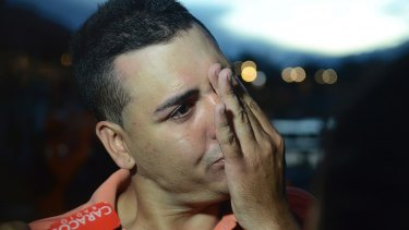 Gilberto Villegas, a ferry passenger, cries as he tells of two relatives missing, in Guatape.