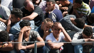 Migrants are detained on their return to Libya on Wednesday.