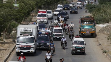 Ambulances take bodies of attack victims to a hospital for autopsies in Karachi, Pakistan.