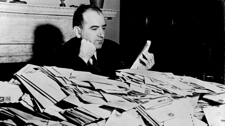 Senator Joseph McCarthy with the avalanche of mail that greeted his crusade against communism in the US government and public life, December 1952.