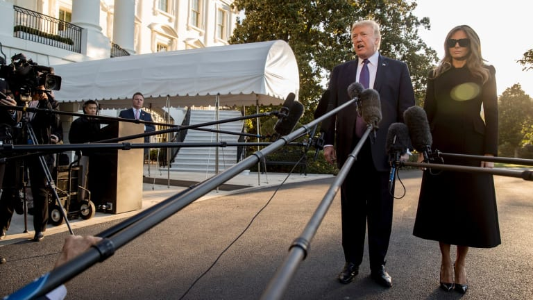 US President Donald Trump, accompanied by first lady Melania Trump, prior to leaving Washington for Las Vegas.