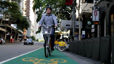 Deputy mayor Adrian Schrinner says Brisbane's inner-city, home of the CityCycle scheme, could benefit from voluntary helmet laws.