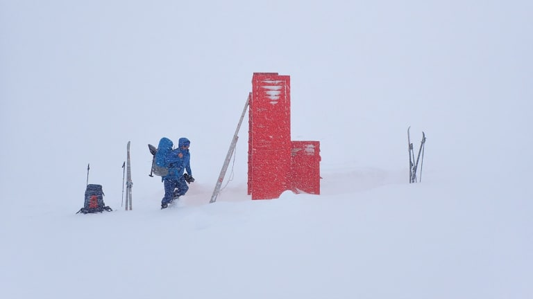The blizzard closes in on Cootapatamba Hut.