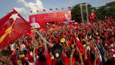 Supporters of Myanmar's opposition leader Aung San Suu Kyi rally in Yangon on Sunday.