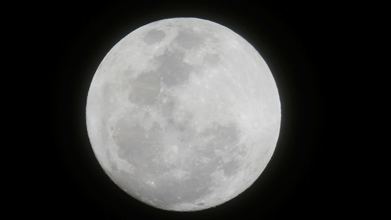 The moon appears in the first supermoon of 2018 as seen from suburban Makati city east of Manila, Philippines, on January 1, 2018.