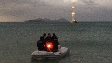 Medical staff boarded an inflatable boat to reach the woman.