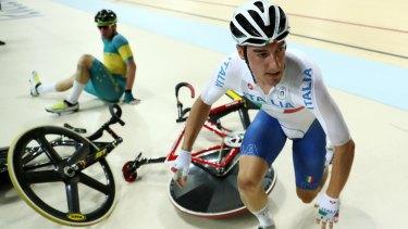 Elia Viviani of Italy and Glenn O'Shea of Australia crash in the omnium.