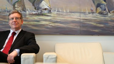 Austbrokers chief executive Mark Searles: The company's underlying net profit fell 15 per cent in the six months to December.