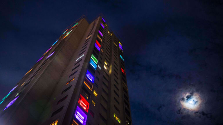 Residents have lit up their windows to show their presence.