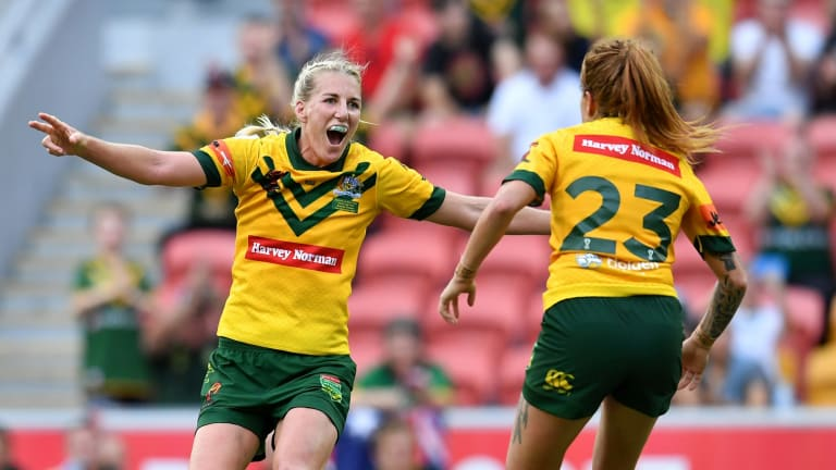 Giant leap for women's rugby league: Ali Brigginshaw, left, and Caitlin Moran celebrate after winning the World Cup last week.