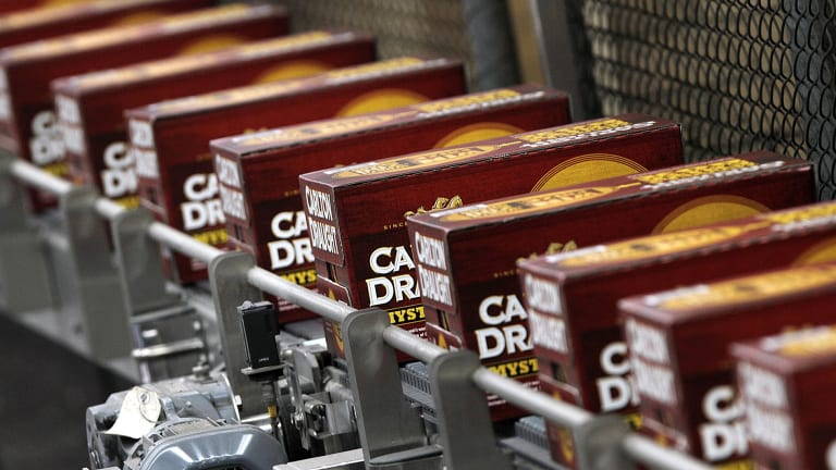 Slabs of Carlton Draught move along a conveyer belt at the giant Abbotsford brewery.