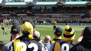 Richmond fans watch training at Punt Road Oval in grand final week.