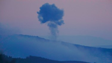 Plumes of smoke rise on the air from inside Syria, as seen from the outskirts of the border town of Kilis, Turkey.