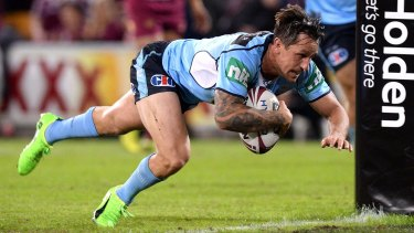 High intensity: Mitchell Pearce crosses the line for the Blues in Origin I this year.