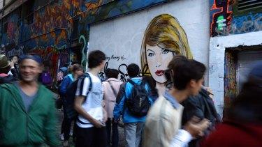 The Taylor Swift mural by Melbourne graffiti artist Lushsux in Hosier Lane.