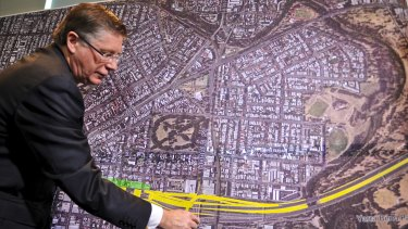 Denis Napthine revealing details of the East West Link last year.