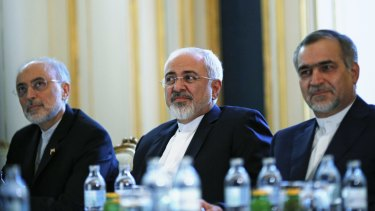 Iranian Foreign Minister Mohammad Javad Zarif, centre, with the head of his country's nuclear organisation, Ali Akbar Salehi, left, and Hossein Fereydoon, brother and close aide to President Hassan Rouhani at the Vienna talks.