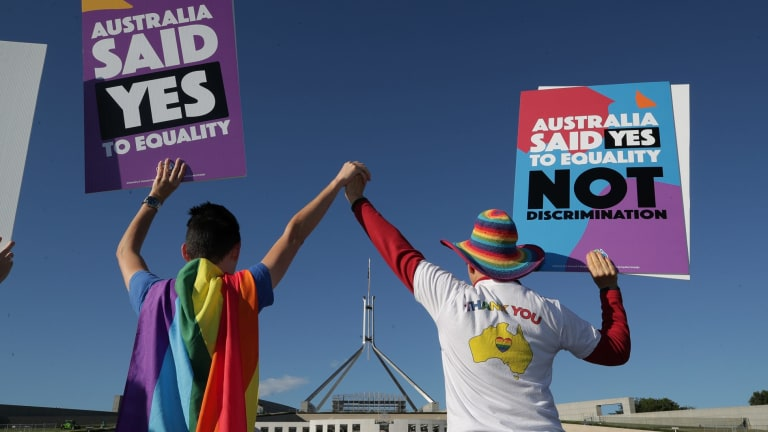 Supporters of same-sex marriage during a rally on the front lawn of Parliament House ahead of the vote on the Marriage Amendment Bill, at Parliament House in Canberra.