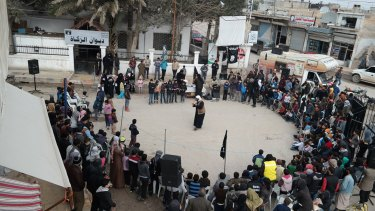 A shot from an IS propaganda website shows a street preaching event at Tel Abyad town in Raqqa province, north-east Syria.