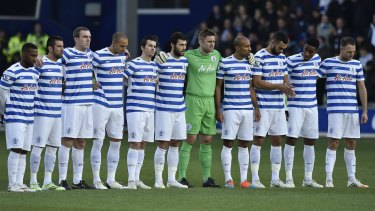 Players from Fernandes-owned QPR stand as a mark of respect.